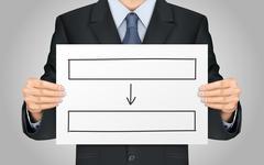 businessman holding blank flow chart poster - stock illustration