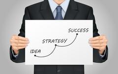businessman holding success concept poster - stock illustration