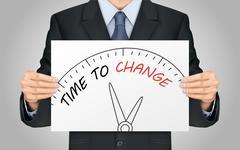 Businessman holding time to change poster Stock Illustration