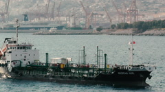 A cargo merchant ship approaching the port Stock Footage