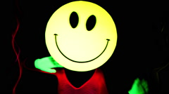 acid smiley emoticon raver sexy woman gogo dancer - stock footage