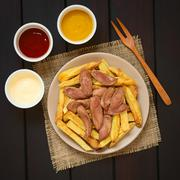 Salchipapas (Fries with Sausage) South American Fast Food - stock photo