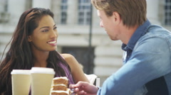 4K Attractive couple at street cafe in the city Stock Footage