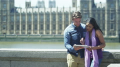 4K Portrait of attractive mixed ethnicity couple with computer tablet in London Stock Footage