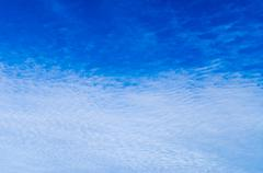 Clouds spreading in blue sky, texture background - stock photo