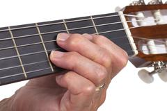 Old hand and guitar isolated Stock Photos