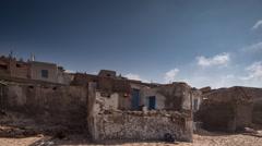 Tifnit fisherman village sand old ruins crumbling Stock Footage