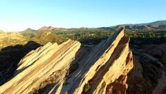 Sunrise flying between Vasquez Rocks Stock Footage