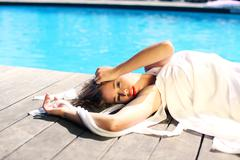 Sexy girl sunbathing on the beach pool tropical - stock photo