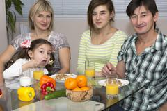 Breakfast of family with mix race different nationality people Stock Photos