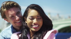 4K Romantic mixed ethnicity couple pose for a selfie in the city.  Stock Footage
