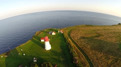 Aerial view over land's end, Cap D'Espoir lighthouse at sunset in Gaspesie Stock Footage