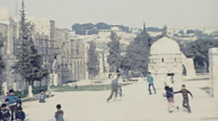 Jerusalem 1975: children playing in front of Dome of the Rock Stock Footage