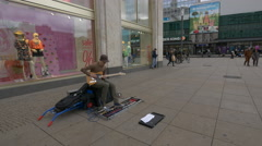 Playing the guitar in Alexanderplatz, Berlin Stock Footage