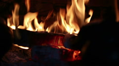 Closeup of flames from the charred wood in the fireplace - stock footage