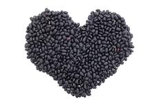 Black turtle beans in a heart shape Stock Photos