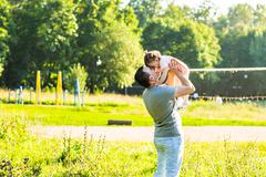 baby girl walking in a summer park with her father - stock photo
