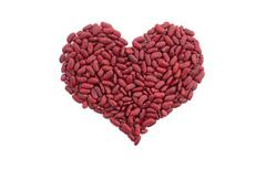 Red kidney beans in a heart shape - stock photo