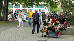 Old russian military hats on sale in Berlin, Germany. Souvenirs from Berlin Stock Footage