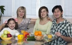 Breakfast of family with mix race different nationality people - stock photo