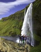 Group of climbers on the waterfall background - stock photo