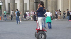 Riding a stand up electric scooter in Pariser Platz, Berlin Stock Footage