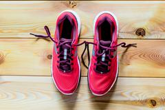 Women's shoes pink for running on asphalt Stock Photos
