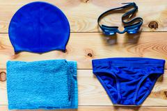 accessories for competitive swimming in the pool for boys - stock photo