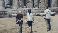 Paestum, Italy 1980: people visiting roman ruins Stock Footage