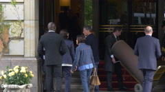 Tourists and employees at the entrance to Adlon Hotel in Berlin Stock Footage
