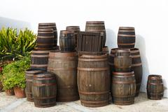 Old wine barrels on a platform Stock Photos