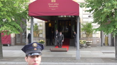 Putting the red carpet at the entrance to Adlon Hotel, Berlin Stock Footage