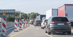 freeway with building lot and traffic jam - stock photo