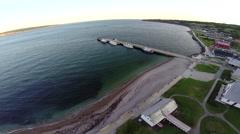 Aerial view over Perce dock and Bonaventure Island in Gaspe Peninsula Stock Footage