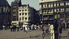 Amsterdam 1970s: people walking in Dam Square Stock Footage