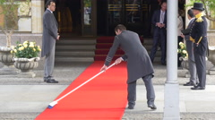 Sweeping the red carpet in front of the Adlon Hotel, Berlin Stock Footage