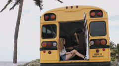 Two friends sitting in bus Stock Footage