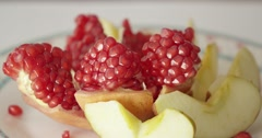 Honey poured on the pomegranate and apples. Jewishs new year Rosh Ha Shana. Stock Footage