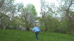 Boy Walking in the Garden Stock Footage