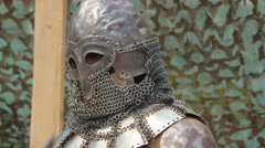 A knight in armor and a helmet with a sword Stock Footage