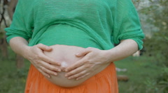 Unborn Baby Pushing the Belly of Pregnant Woman - stock footage