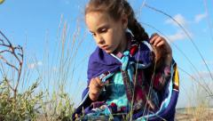Little girl explores the Nature Stock Footage