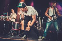 Music band performing on a stage - stock photo