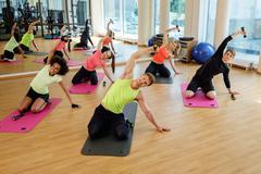 Multiracial group during aerobics class Stock Photos