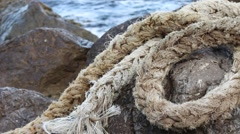 Old Large Rope On The Stone Stock Footage