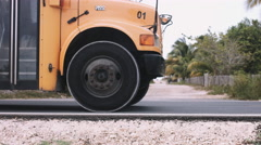 Friends skateboarding holding bus Stock Footage