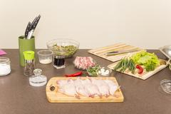 Quails a whole bird and products for stuffing Stock Photos