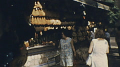 Valencia 1973: ham stand in an outdoor market Stock Footage