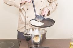 Fry cook pancakes Stock Photos