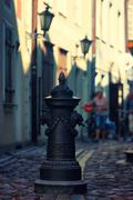 Tourists on a narrow street in Riga in summer Stock Photos